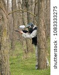 paintball player under attack... | Shutterstock . vector #1083333275