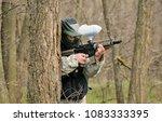 paintball player under attack... | Shutterstock . vector #1083333395