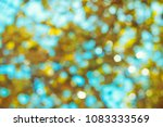 blue sky and yellow leaves ... | Shutterstock . vector #1083333569