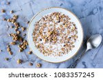 chocolate muesli with milk in a ... | Shutterstock . vector #1083357245