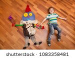 happy kid playing with imagined ... | Shutterstock . vector #1083358481