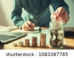 businessman puting coins into... | Shutterstock . vector #1083387785