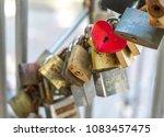 red heart shaped lock among... | Shutterstock . vector #1083457475