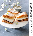 puff pastry cake with whipped... | Shutterstock . vector #1083464837