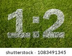 Small photo of 1:2 score on soccer meadow