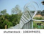 barbed wire entanglements | Shutterstock . vector #1083494051