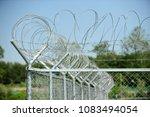 barbed wire entanglements | Shutterstock . vector #1083494054