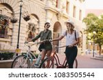 happy young woman walking on a... | Shutterstock . vector #1083505544