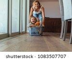 happy young woman pushing kids... | Shutterstock . vector #1083507707