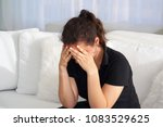 a lonely young woman  she is...   Shutterstock . vector #1083529625