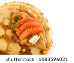 crepes with raw sliced salmon... | Shutterstock . vector #1083596021