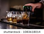 bartender is making cocktail at ... | Shutterstock . vector #1083618014