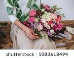 florist makes a bouquet. | Shutterstock . vector #1083618494