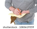 man writes in a vintage notepad ... | Shutterstock . vector #1083619559