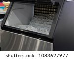 cube ice in ice making machine  ... | Shutterstock . vector #1083627977