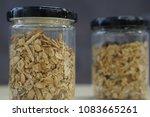 the granola in the glass bottles | Shutterstock . vector #1083665261
