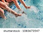 children's feet splashing in... | Shutterstock . vector #1083673547