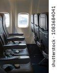 an airplane seat | Shutterstock . vector #1083684041