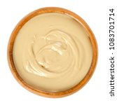 cashew butter in wooden bowl.... | Shutterstock . vector #1083701714