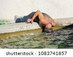 street life  a homeless man... | Shutterstock . vector #1083741857