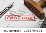 rubber stamp with the text past ... | Shutterstock . vector #1083754901