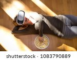 woman is lying with virtual... | Shutterstock . vector #1083790889