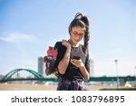 teenage girl in public park | Shutterstock . vector #1083796895