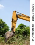 Small photo of Yellow Crawler Backhoe dig
