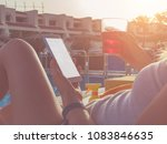 girl using cellphone near the... | Shutterstock . vector #1083846635