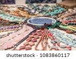 gemstone bracelets and... | Shutterstock . vector #1083860117