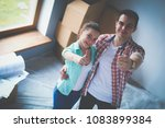 portrait of young couple moving ... | Shutterstock . vector #1083899384