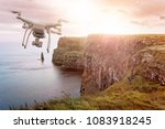 drone flying over the cliffs of ... | Shutterstock . vector #1083918245