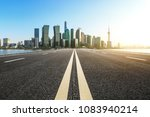empty asphalt road and city... | Shutterstock . vector #1083940214