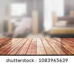 closeup top wood table with... | Shutterstock . vector #1083965639