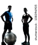 Small photo of one caucasian couple man woman personal trainer coach exercising fitness ball silhouette studio isolated on white background