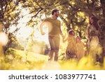 happy family walking trough... | Shutterstock . vector #1083977741