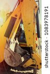 Small photo of Yellow bulldozer with rear view with bucket
