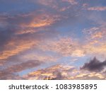 magnificently colored clouds ... | Shutterstock . vector #1083985895
