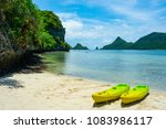 Kayak Boats On Nnatural Beach...