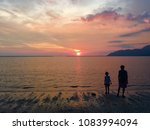 kids watching the sunset at the ... | Shutterstock . vector #1083994094