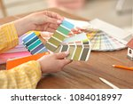 female designer working with... | Shutterstock . vector #1084018997