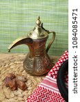 Small photo of Dates fruits and a traditional Qahwa with Gulf coffee usually served during breaking the fast of Ramadan. Beside it is the traditional Bedouin headdres used in Middle East countries esp Saudi Arabia.