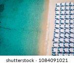 drone view of mykonos island ... | Shutterstock . vector #1084091021