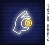 hand with bitcoin neon sign.... | Shutterstock .eps vector #1084138139
