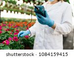 female worker working at plant... | Shutterstock . vector #1084159415