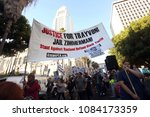 Small photo of Los Angeles, CA/USA - July 16, 2013: People protest in front of Los Angeles City Hall. Demonstrations over the Zimmerman acquittal in the killing of Trayvon Martin continued all day.