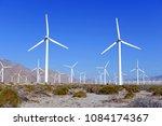 wind turbines creating... | Shutterstock . vector #1084174367