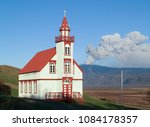 volcanic eruption with church... | Shutterstock . vector #1084178357