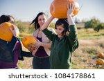 family picking pumpkins at u... | Shutterstock . vector #1084178861