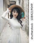 Small photo of Beautiful woman with Vietnam culture traditional dress, Ao dai
